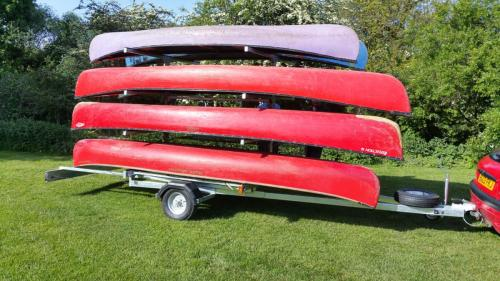 8 boat canoe trailer loaded with canoes